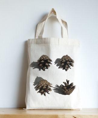 Image of mini tote featuring pine cones photographic print