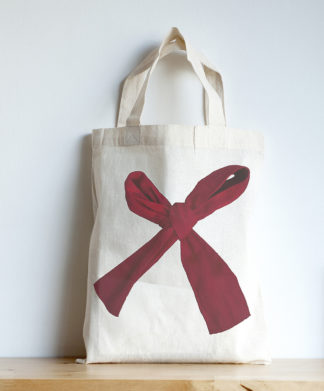 Image of mini tote featuring a red bow photographic print
