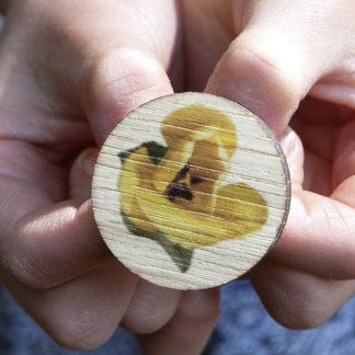 Image of pin badge featuring yellow tulip photo design