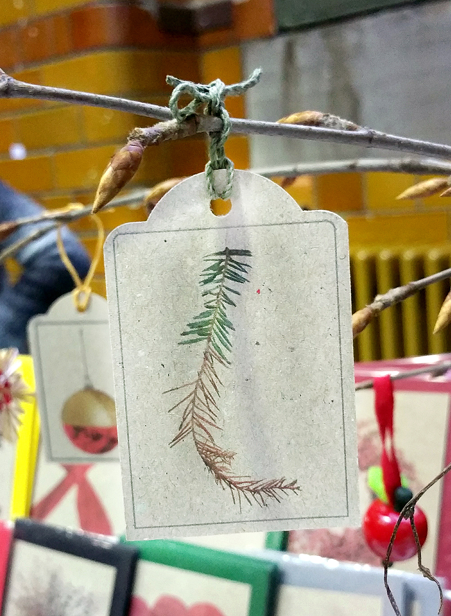 Photo of a gift tag featuring a spruce twig