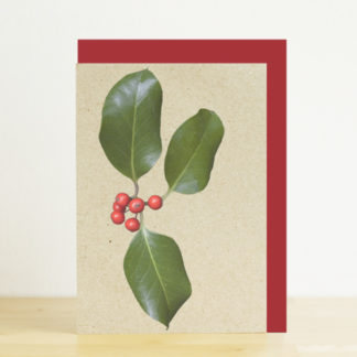 A6 greeting card featuring a photo design of holly with red berries