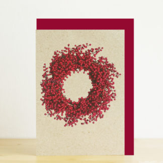 A6 greeting card featuring a photo design of a red berry wreath