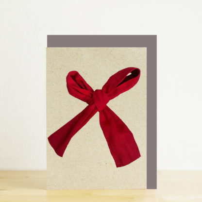 Greeting card featuring a red ribbon bow photo design