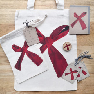 Red ribbon bow gift wrap set including eco-friendly note cards, gift tags, gift bags, wooden pin badge