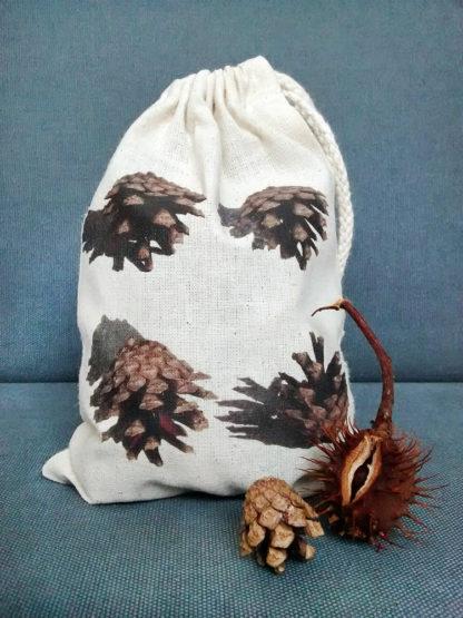 Drawstring bag with pine cones design filled bag