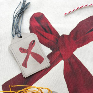 Set of gift tags featuring a red ribbon bow